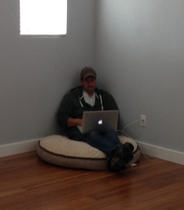 writer on a dog bed